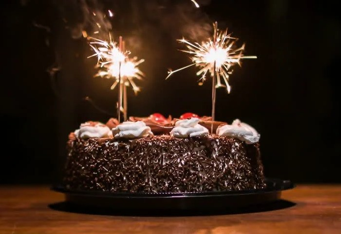 Chocolate Cake With Candles To Celebrate The Birthday