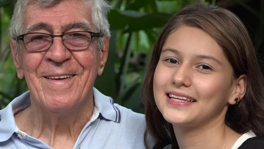 Happy Teen Girl With Grandfather