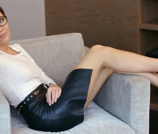 Sexy Business Woman Resting On Armchair She Wearing Black Pencil Skirt White Long Sleeve Shirt And Glasses