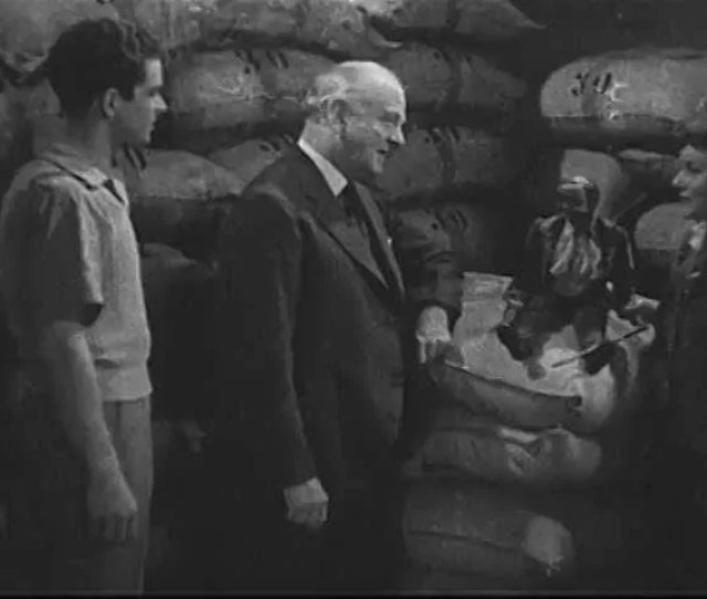 1930s A Scene From A 1930s Film On Coffee Production Shows The Cans In Which Coffee Is Vacuum Sealed As Well As An Interaction Between The Owner Of A