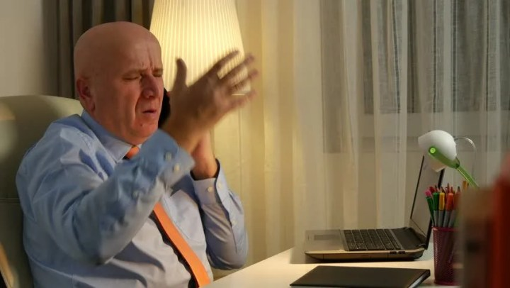 Stock video of businessman in office listen music using   29491447     4k00 32Angry Businessman Talking to Cellphone and Gesturing Nervous and  Irritated  Ultra High Definition  UltraHD  Ultra HD  UHD  4K  3840x2160