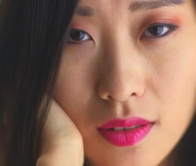 Closeup Of Sexy Chinese Woman Looking At Camera