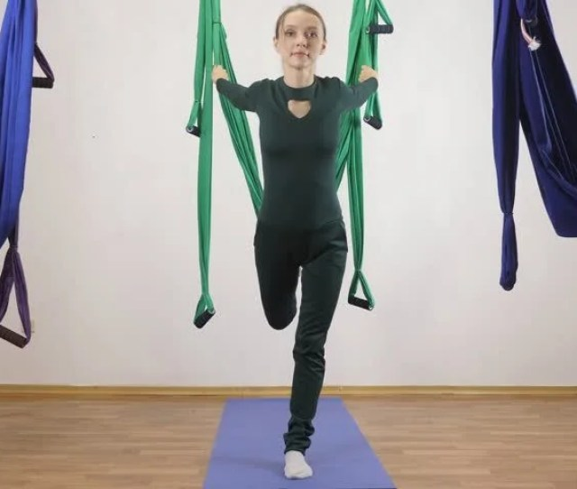 Young Caucasian Woman Making Antigravity Fly Yoga Exercises In Hammock In Studio Indoors Aerial Aero Fly Fitness Trainer Workout High Lunge