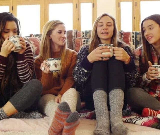 Multi Ethnic Group Of Teen Girls Laugh Over Hot Choc Cookies Christmas Tree