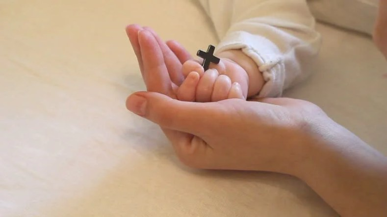 Image result for baby's hand holding cross