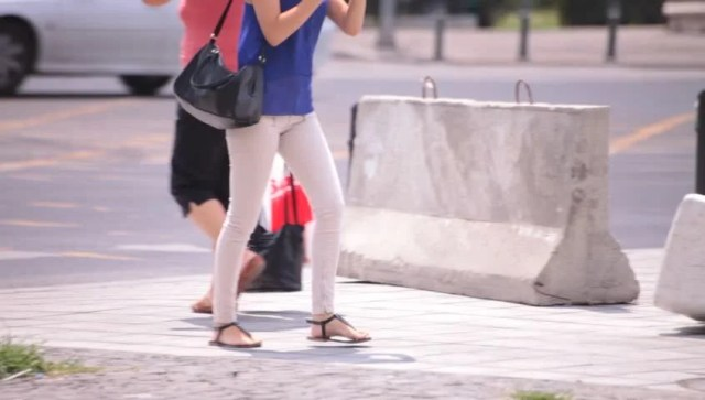 Hot Sexy Legs Of Young Adult Women Walking Down The Street