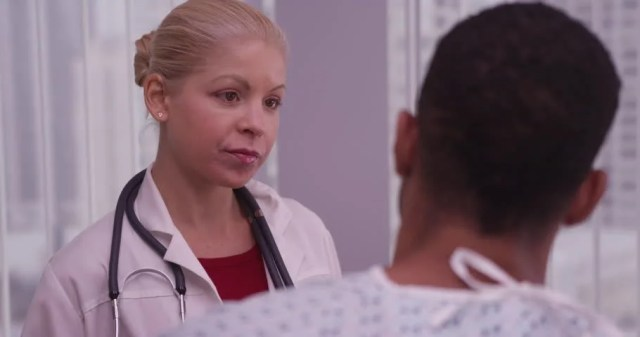 Woman Doctor Listening To Black Patient Talking