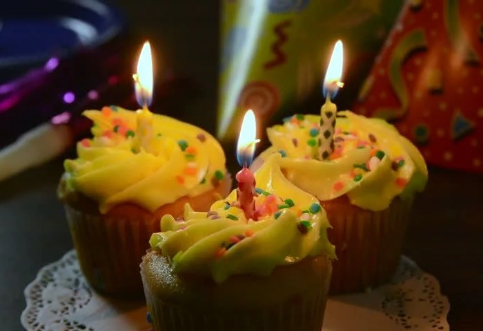 Three Birthday Cupcakes With Candles Stock Footage Video 100