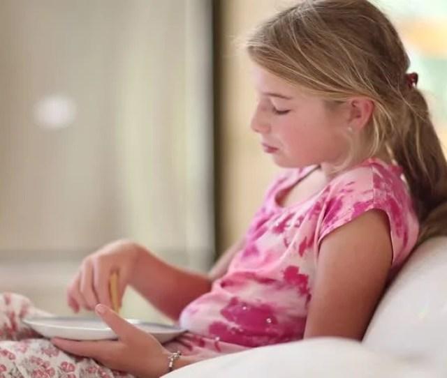 Pre Teen Girl Eating Breakfast Stock Footage Video 100 Royalty Free 13560629 Shutterstock