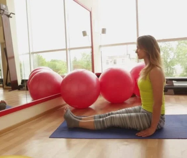 Beautiful Athletic Girl Sits In A Lotus Position And Meditates In The Gym In The Fitness