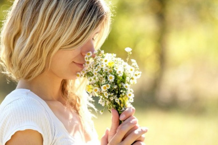 smelling-flowers