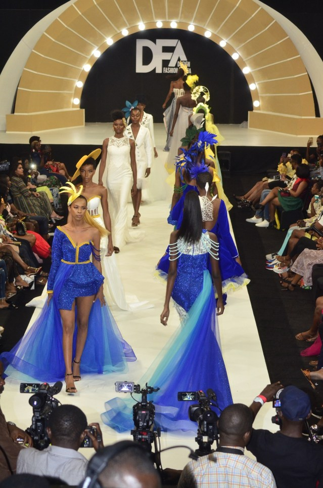 Designers across Africa walking the runway with 54 African countries flags at DFA runway at Eko Hotel Victoria Island Lagos.