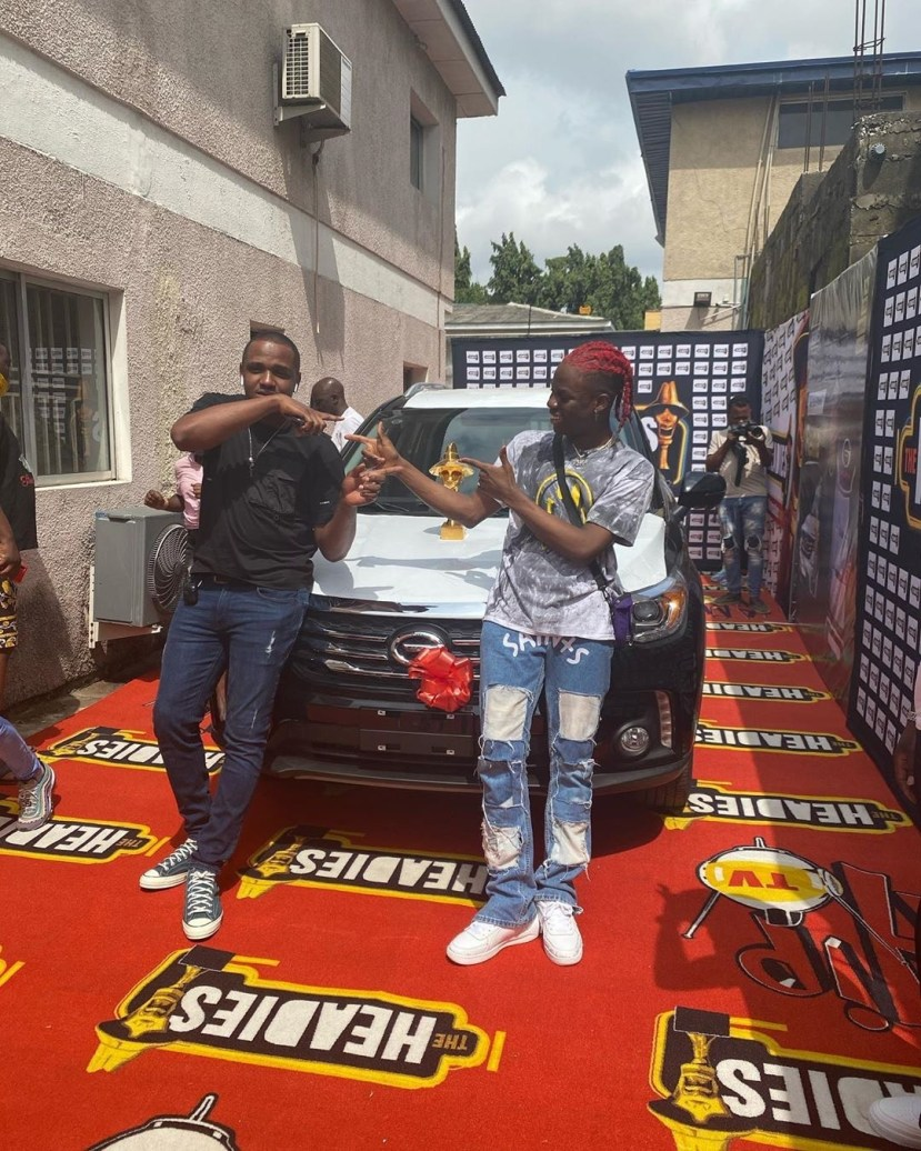 REMA & his Manager Super Sean All Smiles as the artist picks up his Next Rated Car from Headies Awards Organizers lindaikejisblog