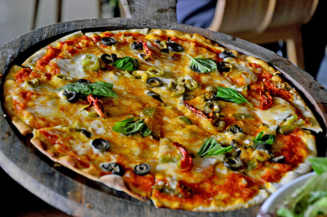 Fio Cookhouse & Bar - Bocconcini, jalapenos, olives, sundried tomatoes pizza | Akanksha Redhu