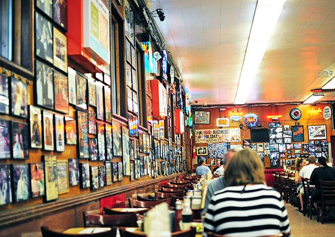 Katz's Delicatessen | #RedhuxNYC | wall with pics