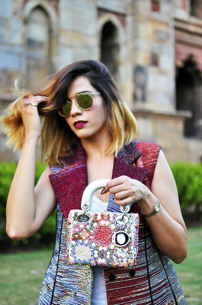 #AIFWSS16 | Dior | Akanksha Redhu | front half holding bag up