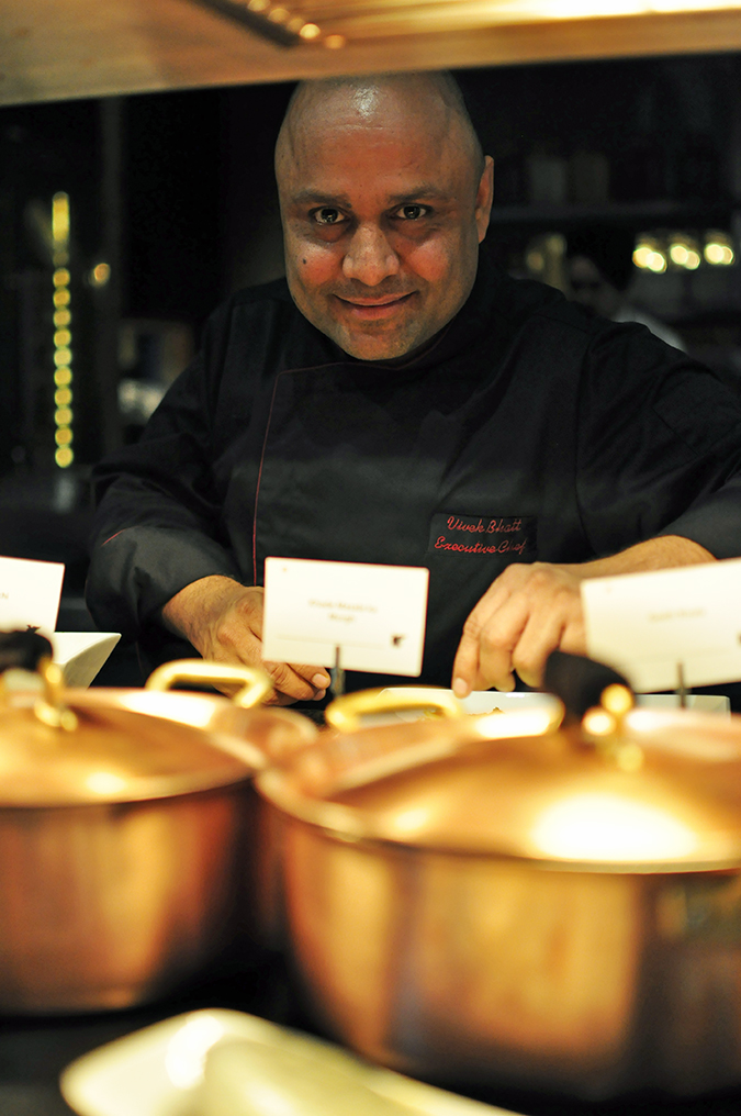 JW Marriott |Chef Vivek Bhatt | Akanksha Redhu | chef over metal containers