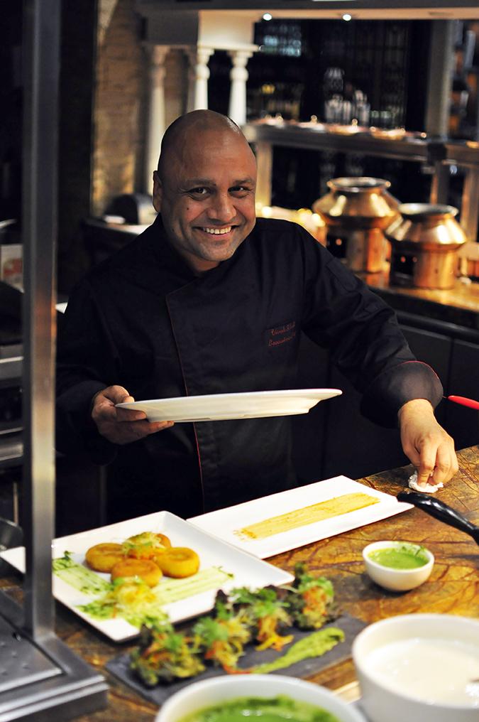 JW Marriott |Chef Vivek Bhatt | Akanksha Redhu | chef with plate in hand smile long