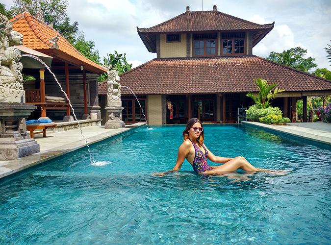 Ubud | Akanksha Redhu | sitting in pool phone wide