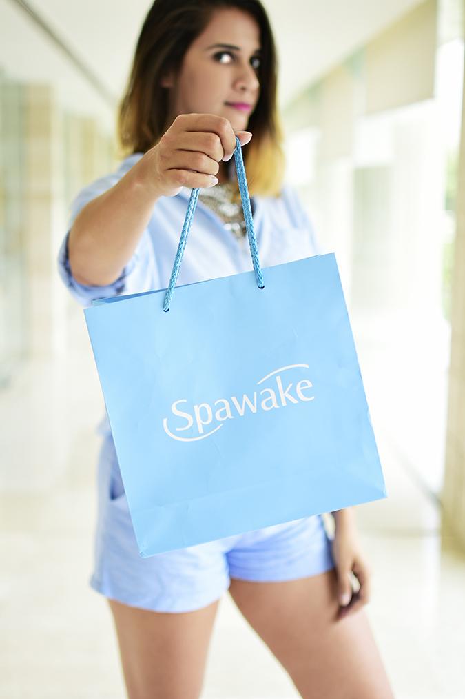 Spawake Whitening Regime | Akanksha Redhu | half front holding baggy in focus