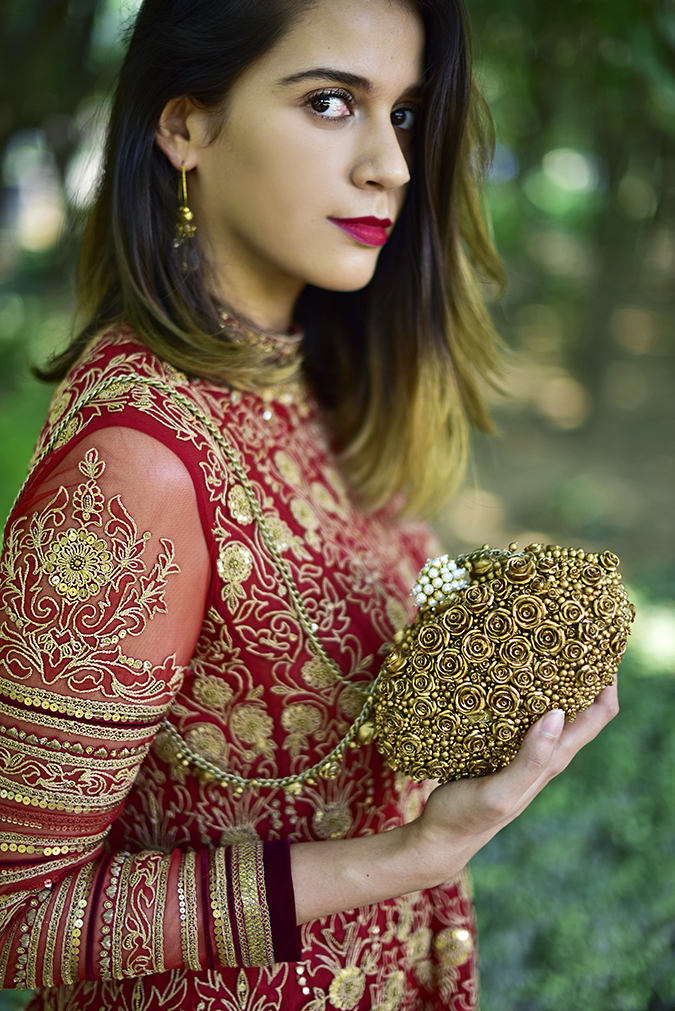 Tarun Tahiliani | Akanksha Redhu | face and bag at level