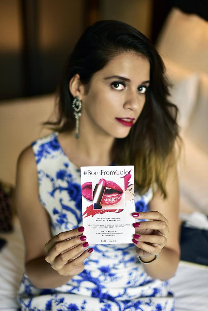 #BornFromColor | Estée Lauder | Akanksha Redhu | sitting holding flyer