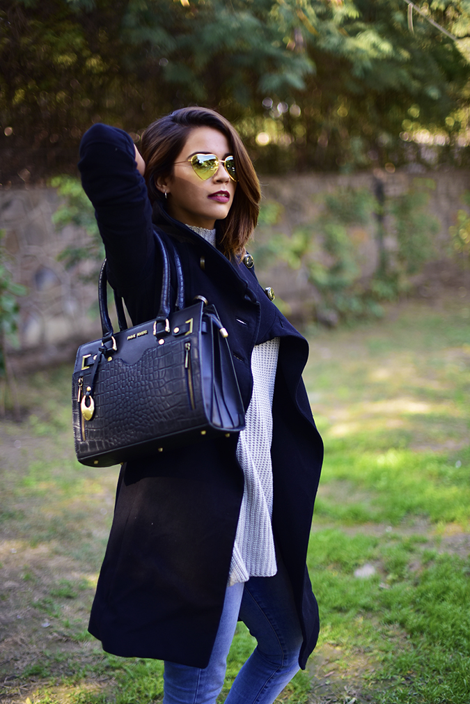 Winter Essentials | Akanksha Redhu | half semi side bag arm raised