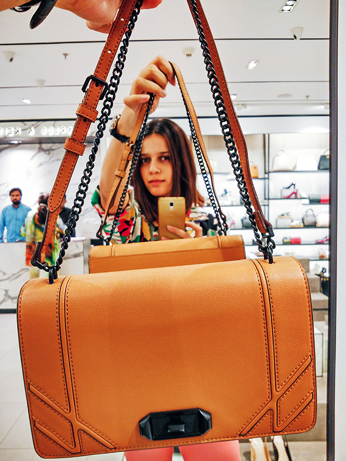 Charles & Keith | Akanksha Redhu | holding bag up