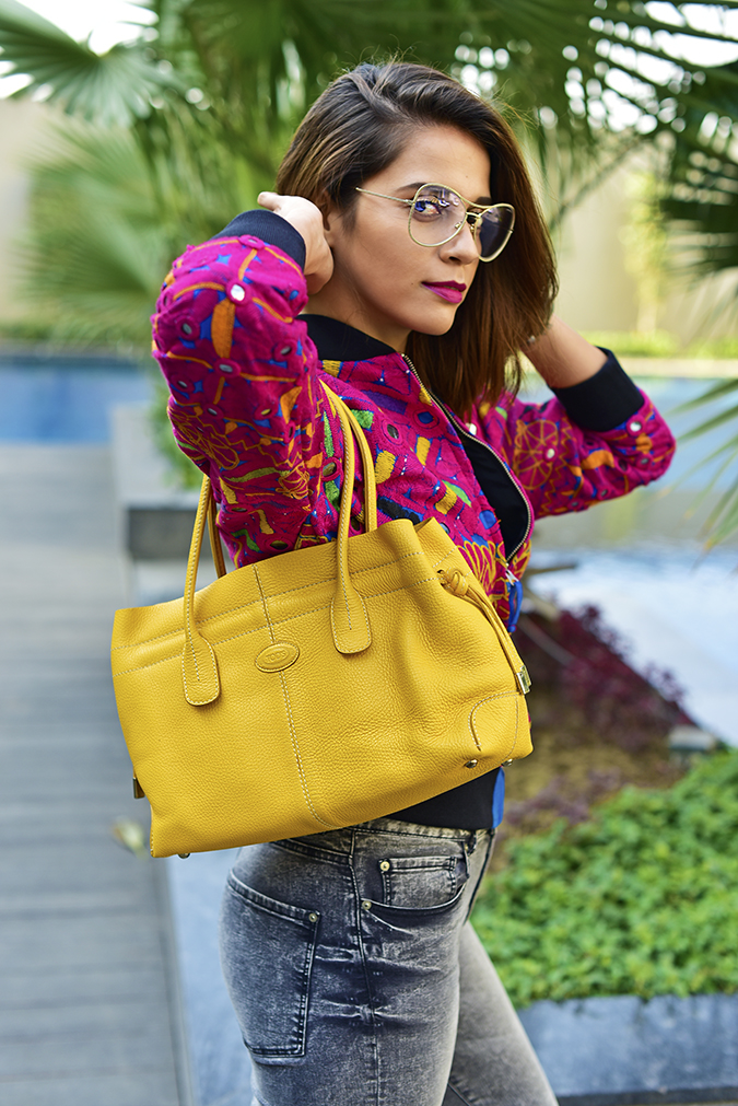 Color Riot | Akanksha Redu | half side arms raised bag