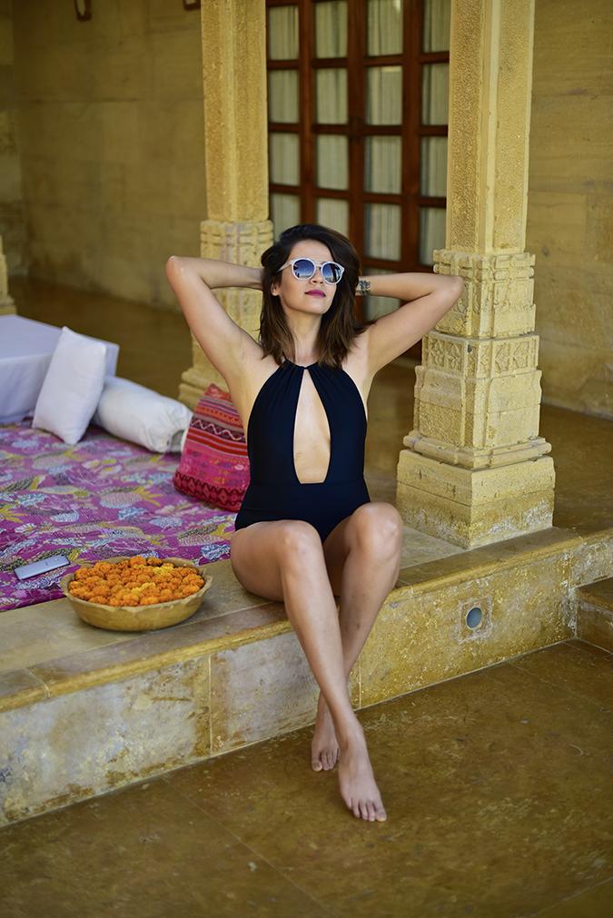 Suryagarh | Akanksha Redhu | sitting legs crossed both arms up
