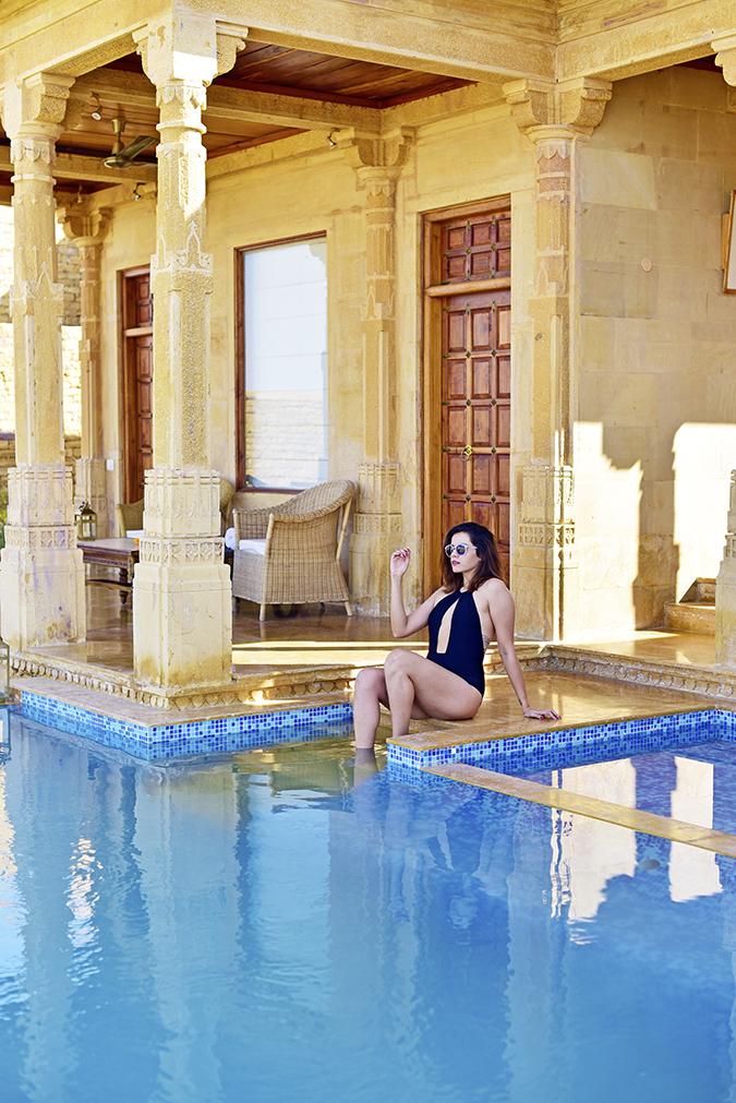 Suryagarh | Akanksha Redhu | legs in pool sitting far