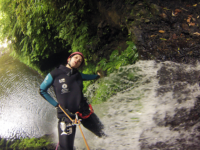 Canyoning in Bali | Akanksha Redhu | me hanging next to waterfall