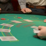 Players playing stud poker with light green baize at A K Casino Knights