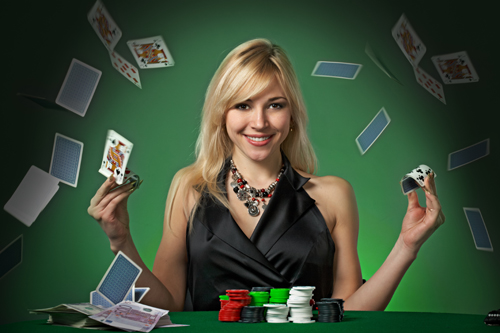 Lady flicking cards at a blackjack table