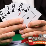 Royal flush held by dealer at casino poker game