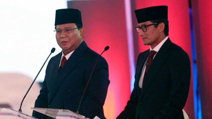 Indonesian presidential candidate Prabowo Subianto delivers his speech from behind a podium.