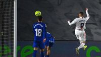 Real Madrid's French forward Karim Benzema (R) scores a goal during the Spanish league football match between Real Madrid CF and Getafe CF at the Alfredo di Stefano stadium in Valdebebas, on the outskirts of Madrid on February 9, 2021. (Photo by GABRIEL BOUYS / AFP)