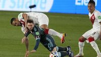 Peru's Alexander Callens, top, and Argentina's Lionel Messi fight for the ball during a qualifying soccer match for the FIFA World Cup Qatar 2022 at Monumental Antonio Vespucio Liberti stadium in Buenos Aires, Argentina, Thursday, Oct.14, 2021. (AP Photo/Natacha Pisarenko)