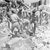 22A-wounded-soldier-is-carried-out-from-the-ruins-of-the-King-David-Hotel-Jerusalem-on-a-stretcher-after-being-hauled-out-from-under-the-wreckage.22-Photo-No-1-Army-Film-Photograp