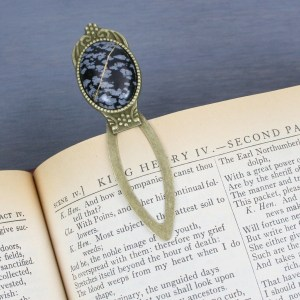 Snowflake obsidian with kintsugi repair on an antiqued brass bookmark