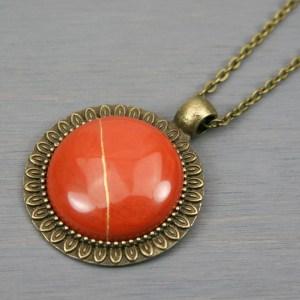 Red jasper kintsugi pendant in antiqued brass setting on chain