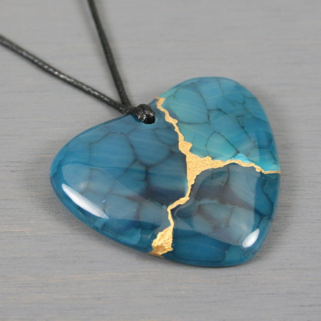 Teal dragon veins agate broken heart pendant with kintsugi repair on black cotton cord