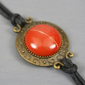 Red jasper kintsugi bracelet in an antiqued brass setting with black cotton cord band