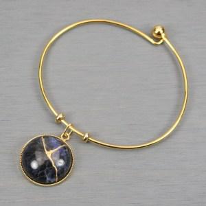Sodalite kintsugi charm on a gold plated bangle bracelet