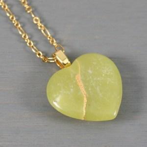 Light green stone broken heart pendant with kintsugi repair on chain necklace