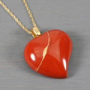 Red jasper broken heart pendant with kintsugi repair on chain necklace