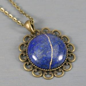 Lapis lazuli kintsugi pendant in antiqued brass setting on chain
