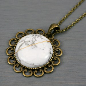 White howlite kintsugi pendant in antiqued brass setting on chain