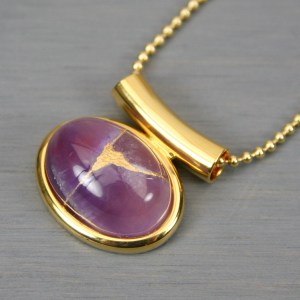 Amethyst small oval kintsugi pendant in a gold setting on chain