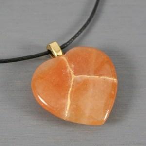 Red aventurine broken heart pendant with kintsugi repair on black cotton cord